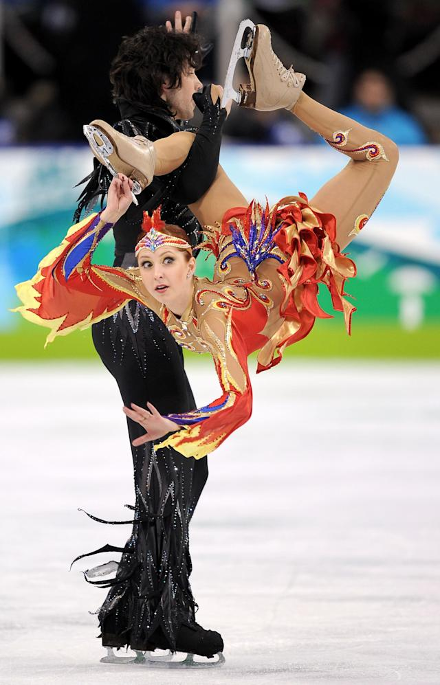 <p>The original girl on fire, Jana Khokhlova went orange and blue with her competition outfit as well as cutouts all over. Her head band also had gems and red and yellow feathers to complete the outfit. </p>