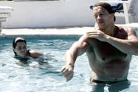 <p>Arnold Schwarzenegger swims with his then-girlfriend Maria Shriver in L.A. in 1979. </p>