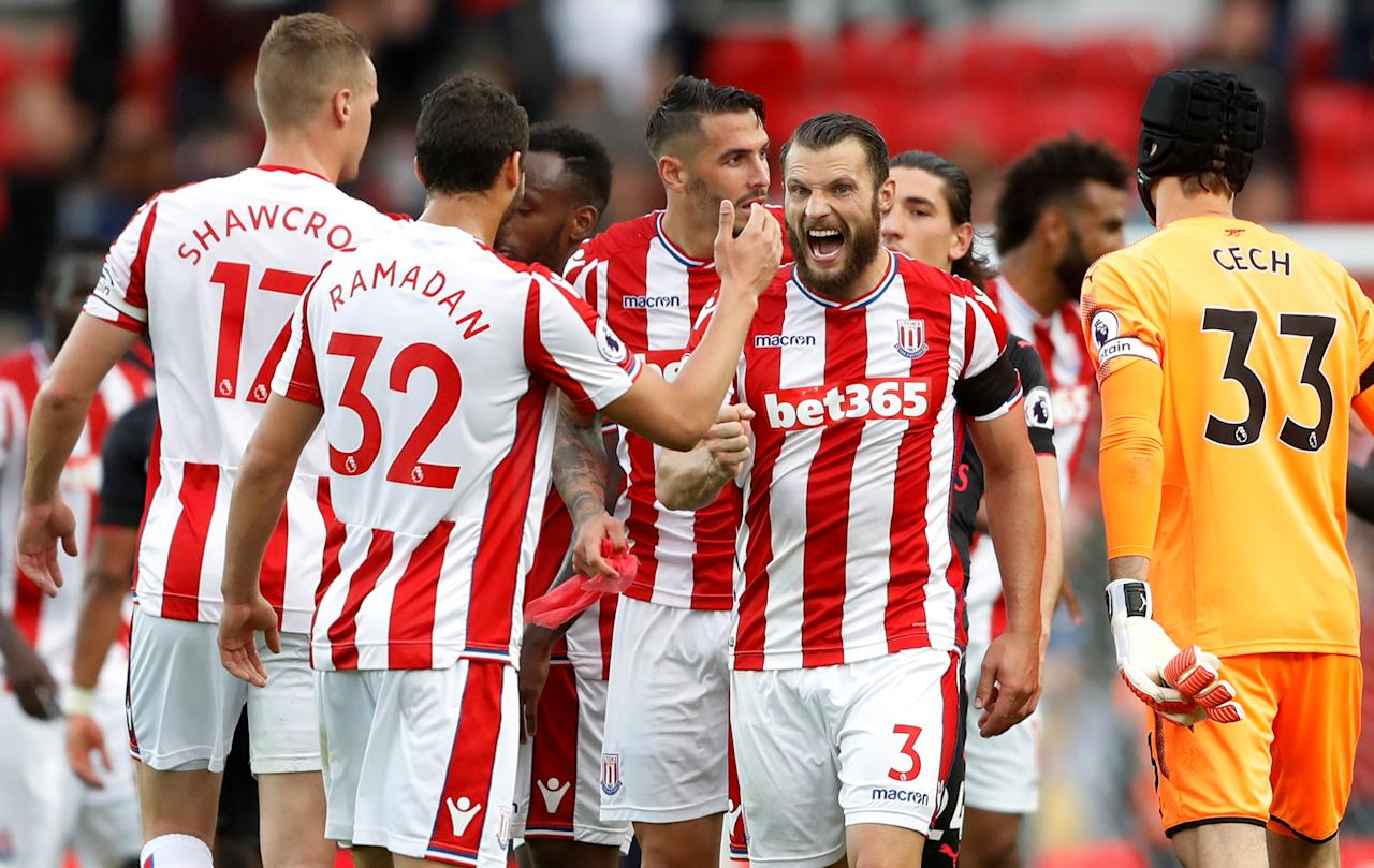 """Football Soccer - Premier League - Stoke City vs Arsenal - Stoke-on-Trent, Britain - August 19, 2017   Stoke City's Erik Pieters and team mates celebrate after the match   Action Images via Reuters/Carl Recine     EDITORIAL USE ONLY. No use with unauthorized audio, video, data, fixture lists, club/league logos or """"live"""" services. Online in-match use limited to 45 images, no video emulation. No use in betting, games or single club/league/player publications. Please contact your account representative for further details.     TPX IMAGES OF THE DAY"""