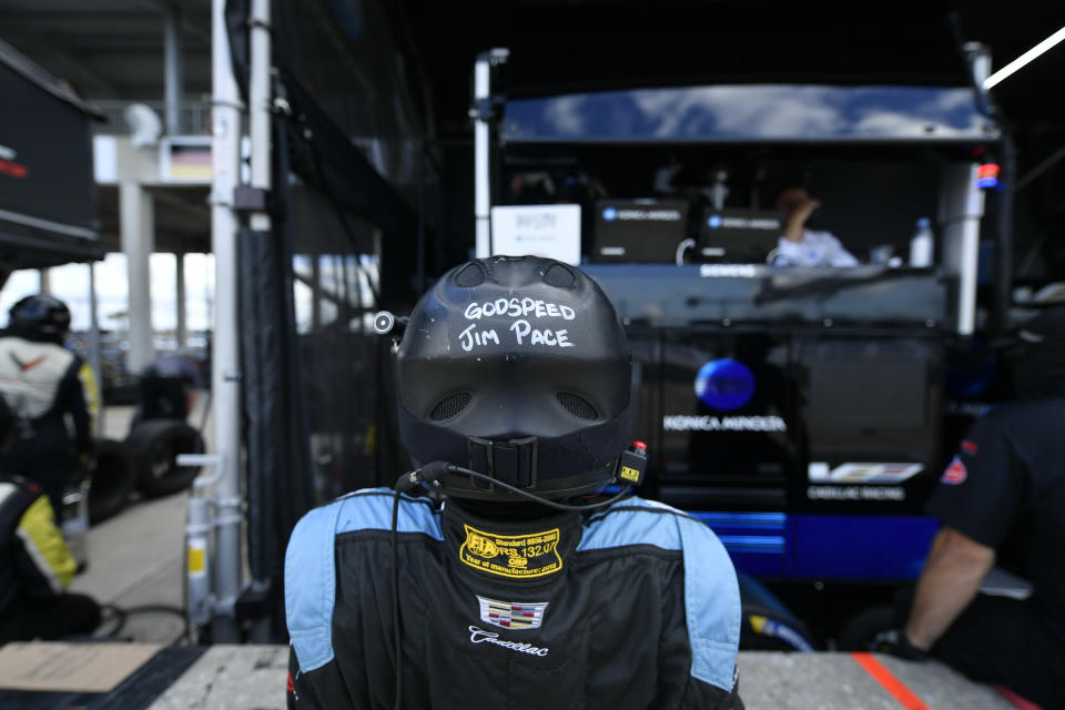 <em>A member of the Wayne Taylor Racing crew wore a helmet carrying a tribute to Jim Pace at the Twelve Hours of Sebring (IMSA).</em>