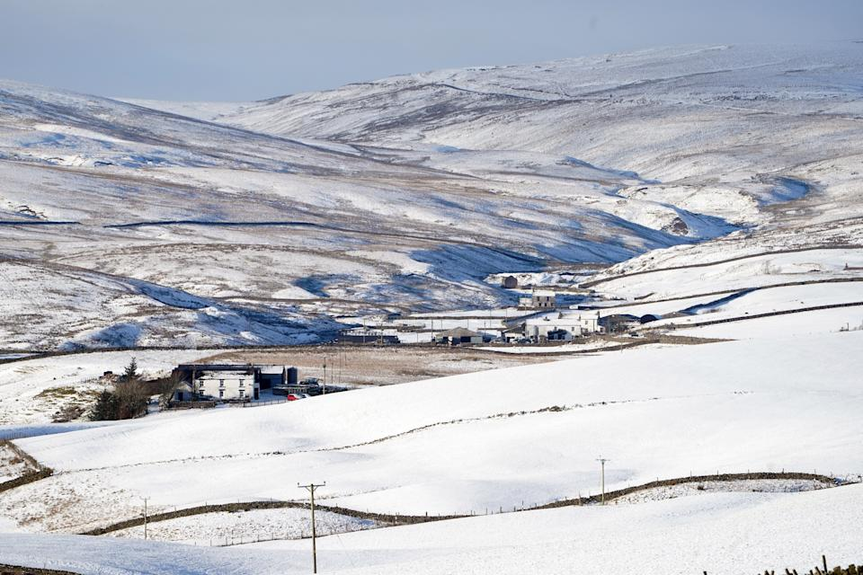 Cottages surrounded by snow in Teesdale in northern England. (PA Images via Getty Images)