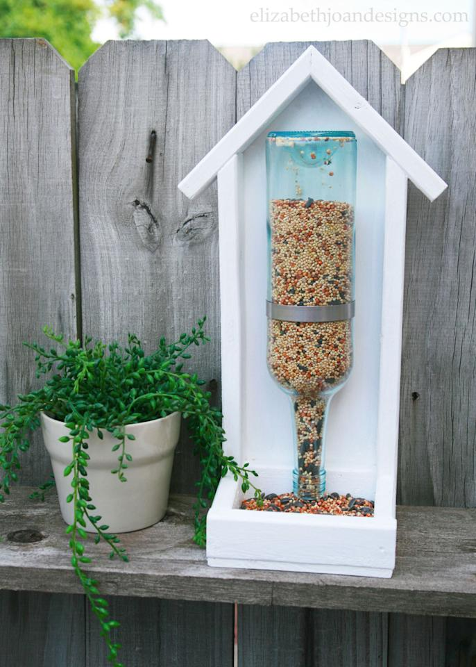 "<p>Wine is a great way to gather friends... and the empty bottles are a sweet way to gather birds. </p><p><strong>Get the tutorial at</strong><span><strong> <a rel=""nofollow"" href=""http://elizabethjoandesigns.com/how-to-build-a-wine-bottle-bird-feeder/"">Elizabeth Joan Designs</a>. </strong></span></p>"