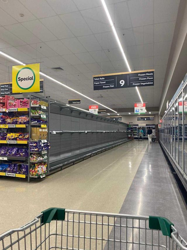 Berala Woolworths (pictured) like many other stores across Australia were wiped clean, as shoppers panicked and started hoarding toilet paper. Source: Cynthia Su