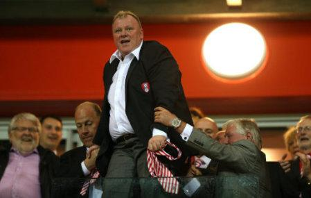 Rotherham's manager Steve Evans celebrates in the stand at the end of the game