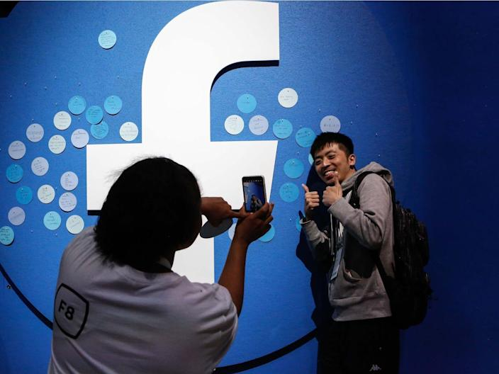 An attendee poses for a picture at the Facebook F8 Conference at McEnery Convention Center in San Jose, California, on April 30, 2019.