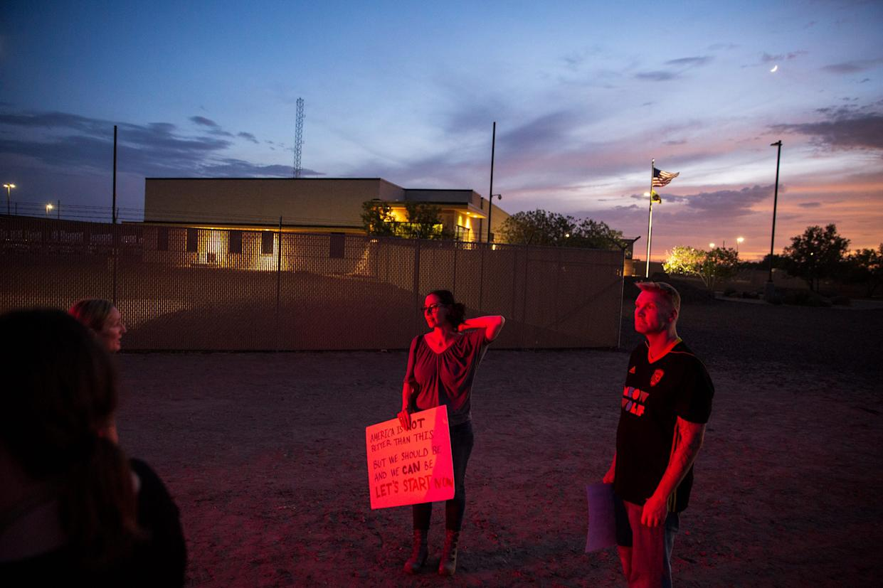 Michelle Kinsey Bruns, from Denver, and Asher Haven, from Santa Fe, protest in front of the Clint, Texas, facility on July 4, 2019.