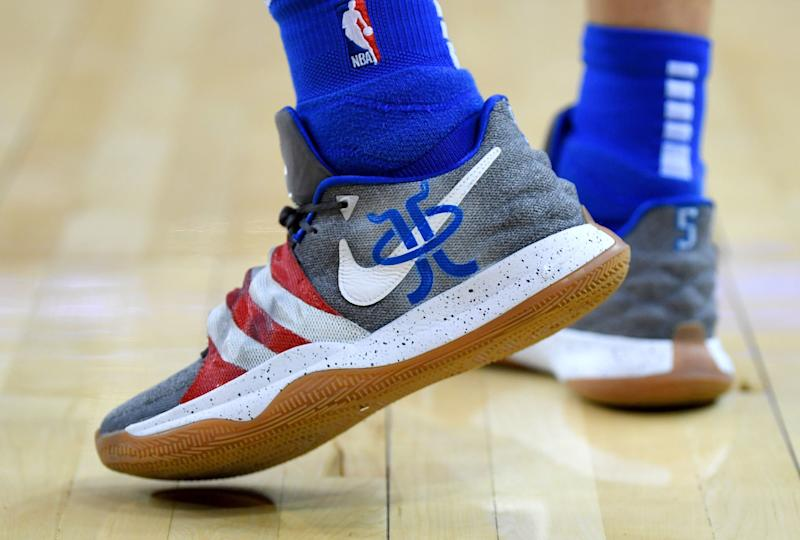 OAKLAND, CA - DECEMBER 22: A detailed view of the Nike 'Kyrie Irving' baketball shoes worn by J.J. Barea #5 of the Dallas Mavericks against the Golden State Warriors during an NBA basketball game at ORACLE Arena on December 22, 2018 in Oakland, California. NOTE TO USER: User expressly acknowledges and agrees that, by downloading and or using this photograph, User is consenting to the terms and conditions of the Getty Images License Agreement. (Photo by Thearon W. Henderson/Getty Images)