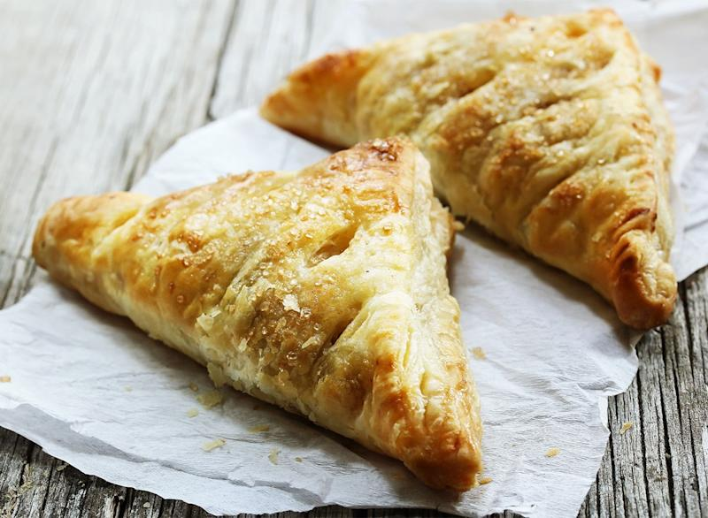 two apple turnovers on paper