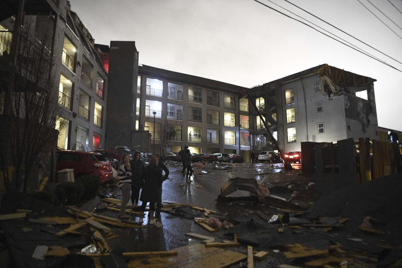 Debris is scattered across the parking lot of a damaged apartment building after a tornado hit Nashville in the early morning hours of Tuesday.