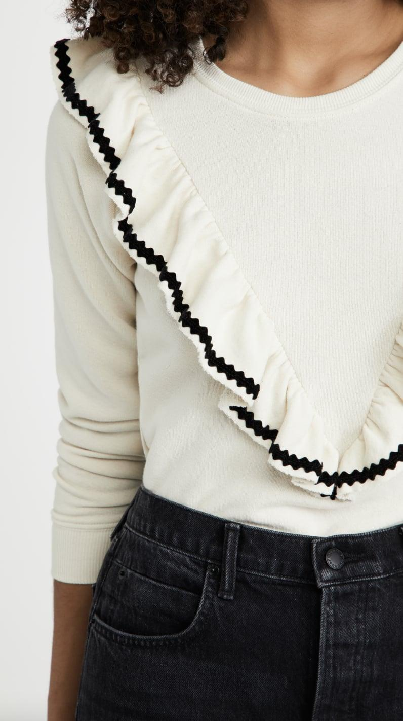 <p>Tap into the statement collar trend with <span>THE GREAT. Shrunken Ruffle Sweatshirt</span> ($215).</p>