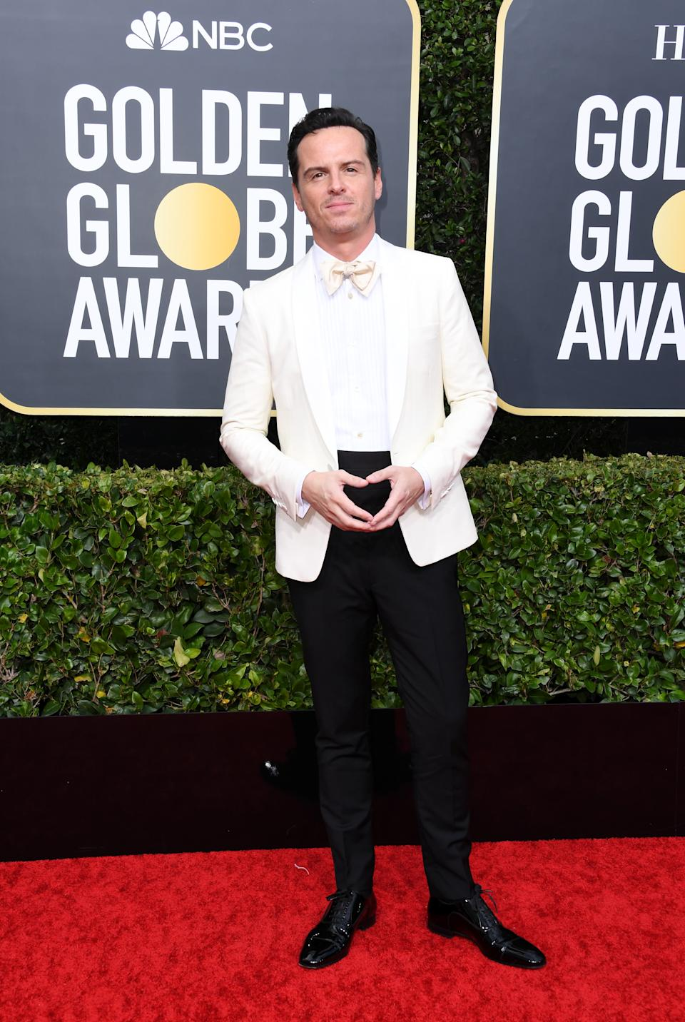 """Two words: Hot Priest. The """"Fleabag"""" star looked dapper in a white jacket and tie as posed for photographers. (Photo by Jon Kopaloff/Getty Images)"""
