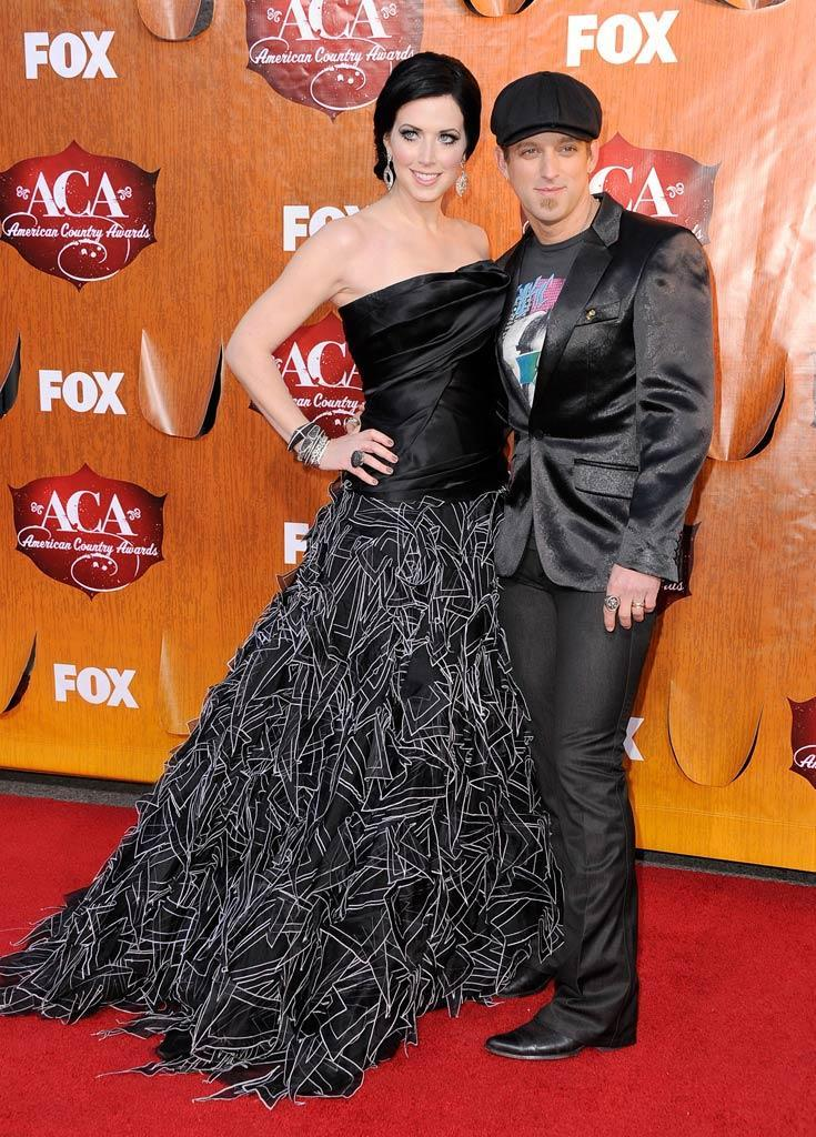 Husband-and-wife duo Shawna and Keifer Thompson of Thompson Square arrive at the American Country Awards held at the MGM Grand Garden Arena in Las Vegas. (12/05/2011)