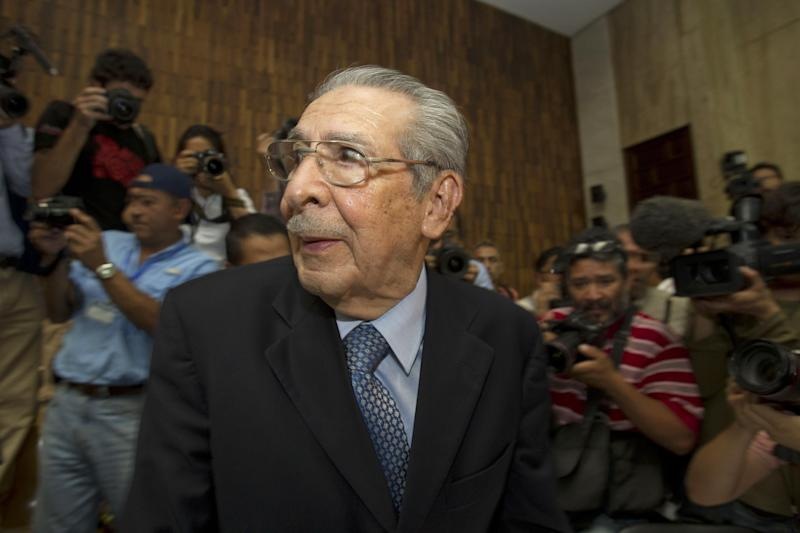 FILE - In this Friday, May 10, 2013 file photo, Guatemala's former dictator Jose Efrain Rios Montt wears headphones as he listens to the verdict in his genocide trial in Guatemala City. Guatemala's top court has overturned the genocide conviction of former dictator Efrain Rios Montt's and ordered his trial to resume. Constitutional Court secretary Martin Guzman says the trial needs to go back to where it stood on April 19 to solve several appeal issues. Monday's ruling comes 10 days after a three-judge panel convicted the 86-year-old Rios Montt of genocide and crimes against humanity for his role in massacres of Mayas during Guatemala's civil war. (AP Photo/Moises Castillo, File)