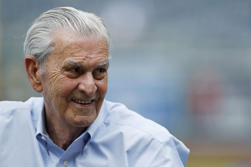 Kansas City Royals owner David Glass reacts as he watches batting practice before the team's baseball game against the Chicago Cubs at Kauffman Stadium in Kansas City, Mo., Tuesday, Aug. 7, 2018. (AP Photo/Colin E. Braley)