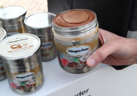 FILE PHOTO: A staff member displays a reusable container of Haagen Dazs ice cream  before the opening of the 152nd Annual General Meeting of Nestle in Lausanne