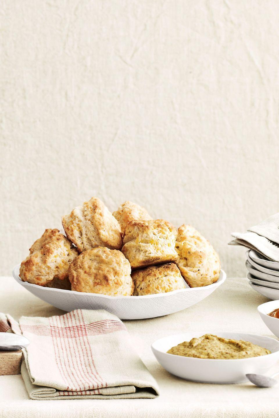 """<p>If savory's more her thing, whip up a batch of fluffy homemade biscuits (with or without gravy!).</p><p><strong><a href=""""https://www.countryliving.com/food-drinks/recipes/a4268/cheddar-biscuits-recipe-clv1212/"""" rel=""""nofollow noopener"""" target=""""_blank"""" data-ylk=""""slk:Get the recipe"""" class=""""link rapid-noclick-resp"""">Get the recipe</a>.</strong></p><p><a class=""""link rapid-noclick-resp"""" href=""""https://www.amazon.com/Nordic-Ware-Natural-Aluminum-Commercial/dp/B0049C2S32/?tag=syn-yahoo-20&ascsubtag=%5Bartid%7C10050.g.1681%5Bsrc%7Cyahoo-us"""" rel=""""nofollow noopener"""" target=""""_blank"""" data-ylk=""""slk:SHOP BAKING SHEETS"""">SHOP BAKING SHEETS</a></p>"""