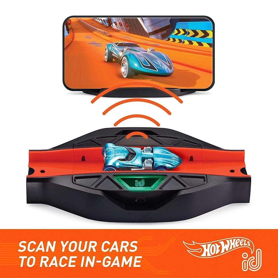 """<p><strong>Hot Wheels</strong></p><p>amazon.com</p><p><strong>$18.29</strong></p><p><a href=""""https://www.amazon.com/dp/B07NDXGJK3?tag=syn-yahoo-20&ascsubtag=%5Bartid%7C10055.g.29385769%5Bsrc%7Cyahoo-us"""" rel=""""nofollow noopener"""" target=""""_blank"""" data-ylk=""""slk:Shop Now"""" class=""""link rapid-noclick-resp"""">Shop Now</a></p><p>Pair this race portal set with a smart phone or tablet and the free Hot Wheels id digital app for a <strong>super innovative augmented reality experience</strong>. Once he scans his car onto the race track and into the digital garage, your 6-year-old can race, measure car performance and play mini games that launch his cars from the physical track into digital challenges. Each car he scans unlocks unique content, and this set already comes with two exclusive Hot Wheels cars. <em>Ages 6+</em><br></p><p><strong>RELATED:</strong> <a href=""""https://www.goodhousekeeping.com/childrens-products/toy-reviews/g28243507/best-toys-gifts-for-8-year-boys/"""" rel=""""nofollow noopener"""" target=""""_blank"""" data-ylk=""""slk:20 Best Toys for 8-Year-Old Boys, According to Kids and Toy Experts"""" class=""""link rapid-noclick-resp"""">20 Best Toys for 8-Year-Old Boys, According to Kids and Toy Experts</a><br></p>"""