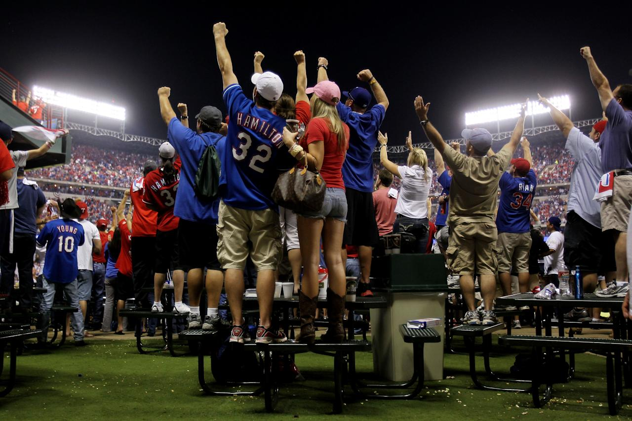 ARLINGTON, TX - OCTOBER 24: Fans cheer after a home run by Mitch Moreland #18 of the Texas Rangers in the third inning during Game Five of the MLB World Series against the St. Louis Cardinals at Rangers Ballpark in Arlington on October 24, 2011 in Arlington, Texas.  (Photo by Ezra Shaw/Getty Images)