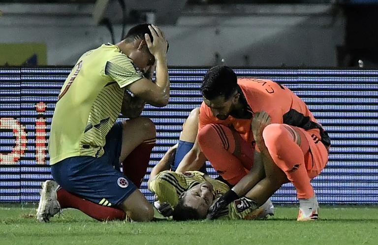 Colombia defender Santiago Arias (c) is expected to be sidelined for six months after breaking his leg in a 2022 World Cup qualifier against Venezuela