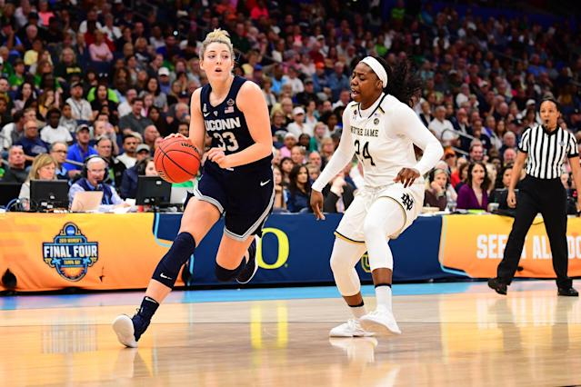 "TAMPA, FL - APRIL 05: Katie Lou Samuelson #33 of the <a class=""link rapid-noclick-resp"" href=""/ncaaf/teams/connecticut/"" data-ylk=""slk:Connecticut Huskies"">Connecticut Huskies</a> dribbles past Arike Ogunbowale #24 of the <a class=""link rapid-noclick-resp"" href=""/ncaaf/teams/notre-dame/"" data-ylk=""slk:Notre Dame Fighting Irish"">Notre Dame Fighting Irish</a> at Amalie Arena on April 5, 2019 in Tampa, Florida. (Photo by Ben Solomon/NCAA Photos via Getty Images)"