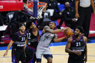 Washington Wizards' Bradley Beal (3) goes up for a shot against Philadelphia 76ers' Tobias Harris (12) during the second half of Game 1 of a first-round NBA basketball playoff series, Sunday, May 23, 2021, in Philadelphia. (AP Photo/Matt Slocum)