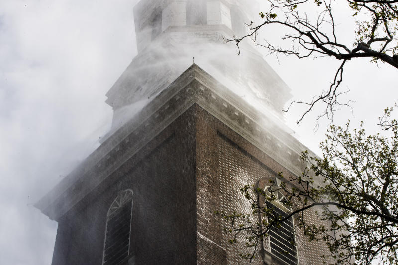 The historic Christ Church test its fire suppression system ahead of summer renovations in Philadelphia, Wednesday, April 17, 2019. (AP Photo/Matt Rourke)