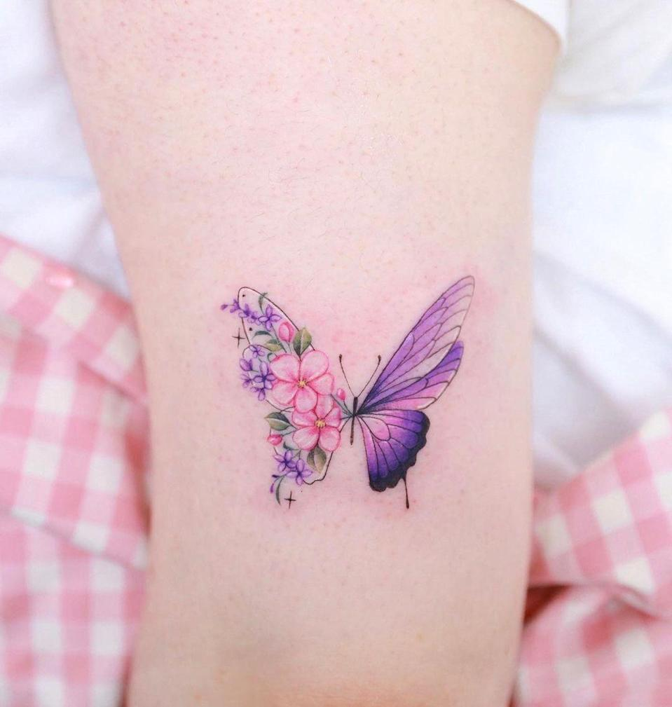 This butterfly tattoo, which features lilacs and apple blossoms in its wings, is the more modern take on the '90s trend.