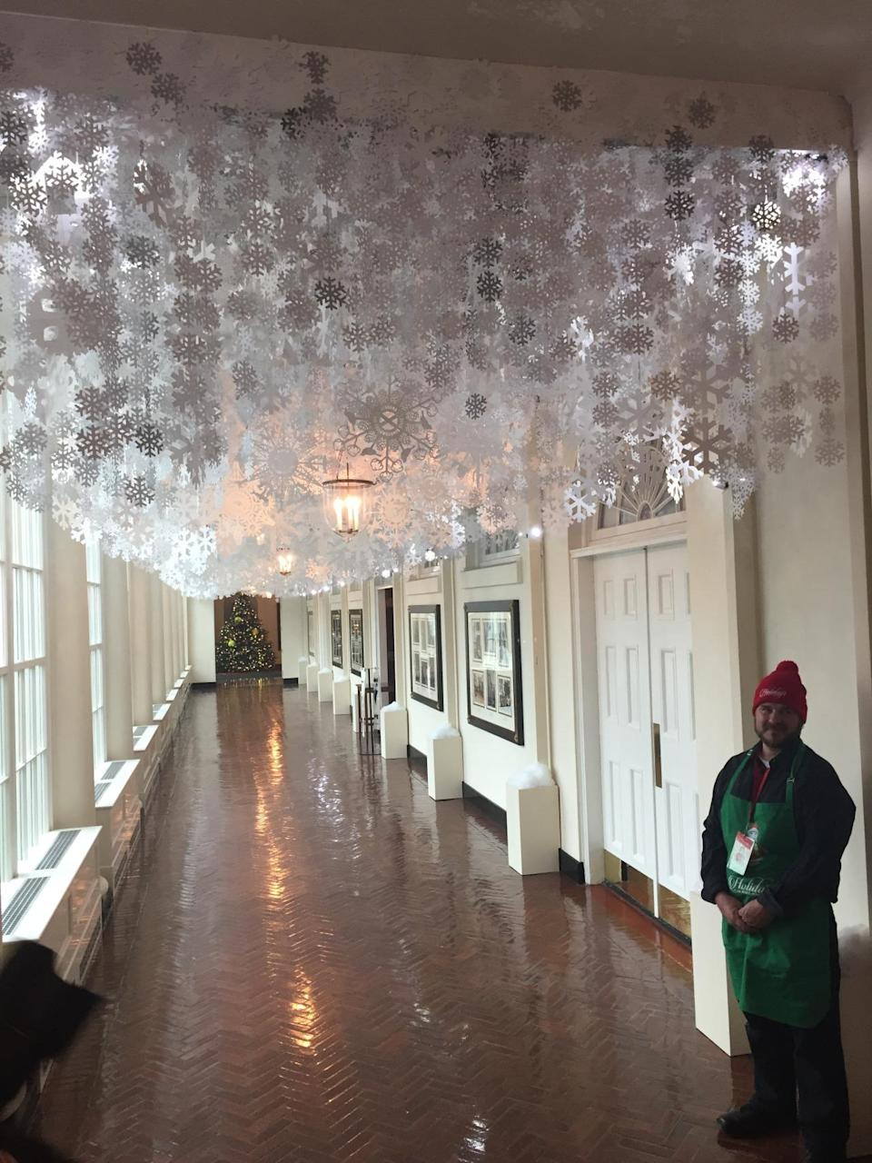 """<p>Visitors walk under hand-cut paper snowflakes in the East Colonnade as a tribute to first lady Michelle Obama's <a href=""""https://www.whitehouse.gov/reach-higher"""" rel=""""nofollow noopener"""" target=""""_blank"""" data-ylk=""""slk:Reach Higher initiative"""" class=""""link rapid-noclick-resp"""">Reach Higher initiative</a>. <i>(Photo: Cassie Carothers)</i></p>"""