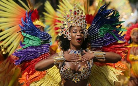 Costumed revellers perform in the Notting Hill Carnival in London, Monday, Aug. 28, 2017.  - Credit: AP Photo/Time Ireland