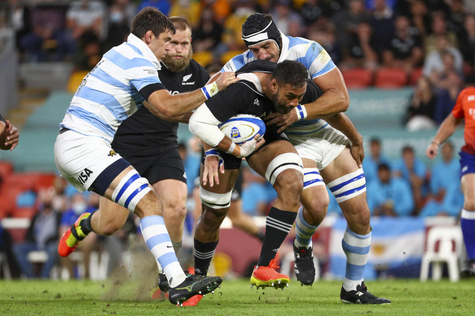 New Zealand's Patrick Tuipulotu is tackled by defenders during the Rugby Championship test match between the All Blacks and the Pumas in Brisbane, Australia, Saturday, Sept. 18, 2021. (AP Photo/Tertius Pickard)