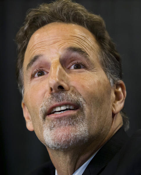 Vancouver Canucks coach John Tortorella speaks during a news conference after he was hired by the NHL hockey team in Vancouver, British Columbia, on Tuesday, June 25, 2013. (AP Photo/The Canadian Press, Darryl Dyck)