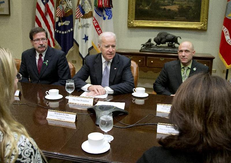 Vice President Joe Biden meets with Newtown shooting family members, including Bill Sherlach, widower of school psychologist Mary Sherlach, left, and Jeremy Richman, father of Avielle Richman, right, during a photo opportunity before a meeting in the Roosevelt Room of the White House in Washington, Tuesday, Dec. 10, 2013, about the administration's efforts to increase access to mental health services. (AP Photo/Carolyn Kaster)