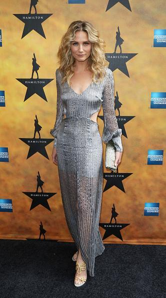 <p>The Sugarland country star was more rock & roll in a silver gown. The dress featured side cutouts and sheer, showing a lot of skin, and she paired it with gold heels.</p>