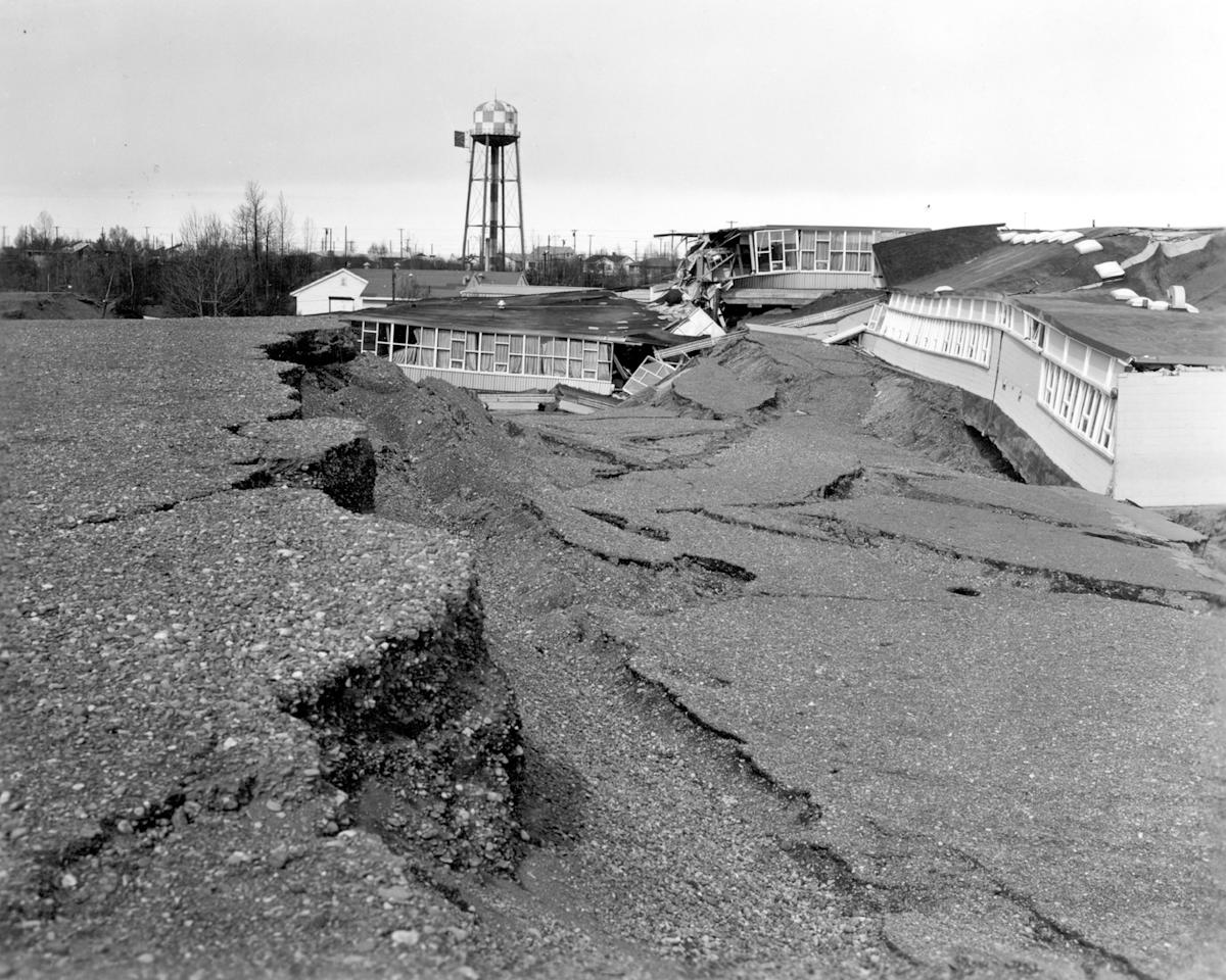 In this March 1964 photo released by the U.S. Geological Survey, the Government Hill Elementary School is shown destroyed following an earthquake in Anchorage, Alaska. North America's largest earthquake rattled Alaska 50 years ago, killing 15 people and creating a tsunami that killed 124 more from Alaska to California. The magnitude 9.2 quake hit at 5:30 p.m. on Good Friday, turning soil beneath parts of Anchorage into jelly and collapsing buildings that were not engineered to withstand the force of colliding continental plates. (AP Photo/U.S. Geological Survey)