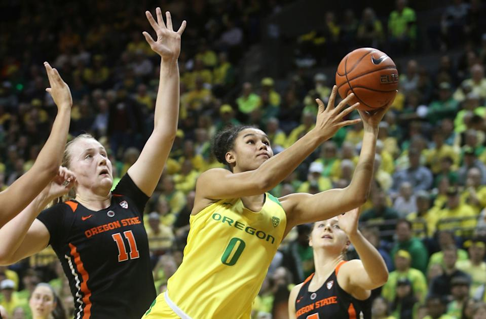 Oregon's Satou Sabally, center, and Oregon State's Mikayla Pivec will battle again this weekend. (AP Photo/Chris Pietsch)