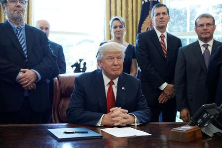 U.S. President Donald Trump speaks before signing a directive ordering an investigation into the impact of foreign steel on the American economy in the Oval Office of the White House