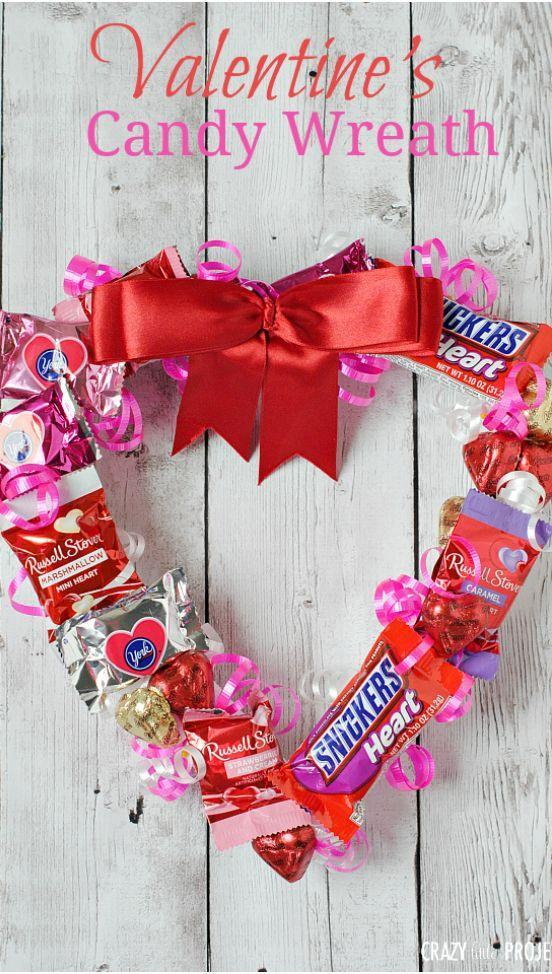"""<p>Make this fun, tasty wreath with your kids and see how long it takes before all the candy is missing from it!</p><p><strong>Get the tutorial at <a href=""""https://crazylittleprojects.com/valentines-candy-wreath/"""" rel=""""nofollow noopener"""" target=""""_blank"""" data-ylk=""""slk:Crazy Little Projects"""" class=""""link rapid-noclick-resp"""">Crazy Little Projects</a>.</strong></p><p><a class=""""link rapid-noclick-resp"""" href=""""https://www.amazon.com/Valentines-Assortment-Chocolate-Hersheys-Miniatures/dp/B08NFD9GV8/ref=sr_1_8?tag=syn-yahoo-20&ascsubtag=%5Bartid%7C10050.g.1584%5Bsrc%7Cyahoo-us"""" rel=""""nofollow noopener"""" target=""""_blank"""" data-ylk=""""slk:SHOP CANDY"""">SHOP CANDY</a><strong><br></strong></p>"""