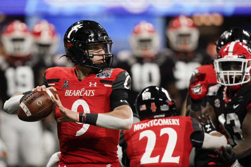 Cincinnati quarterback Desmond Ridder (9) sits in the pocket against Georgia during the first half of the Peach Bowl college football game on Jan. 1. (AP)