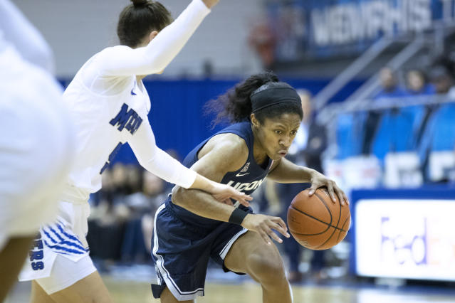Connecticut guard Chrystal Dangerfield, right, drives to the basket defended by Memphis guard Aerial Wilson, left, in the first half of an NCAA college basketball game Tuesday, Jan. 14, 2020, in Memphis, Tenn. (AP Photo/Nikki Boertman)