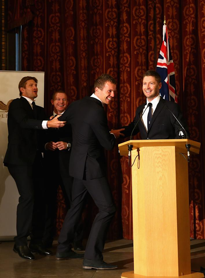 LONDON, ENGLAND - JULY 16:  Shane Watson (L) and Michael Clarke (R) pull Peter Siddle (C) away from the microphone during the Australian Cricket Team visit to the Australian High Commision on July 16, 2013 in London, England.  (Photo by Ryan Pierse/Getty Images)