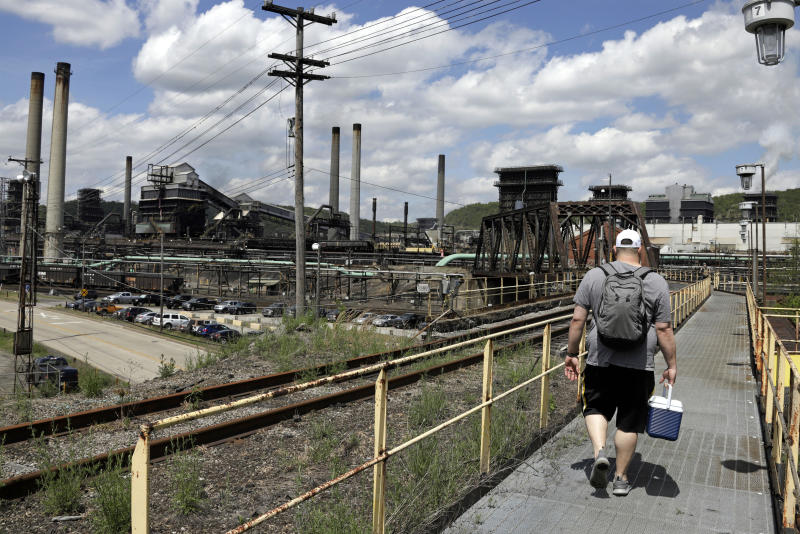 FILE - In this May 2, 2019, file photo a worker arrives for his shift at the U.S. Steel Clairton Coke Works in Clairton, Pa. (AP Photo/Gene J. Puskar, File)