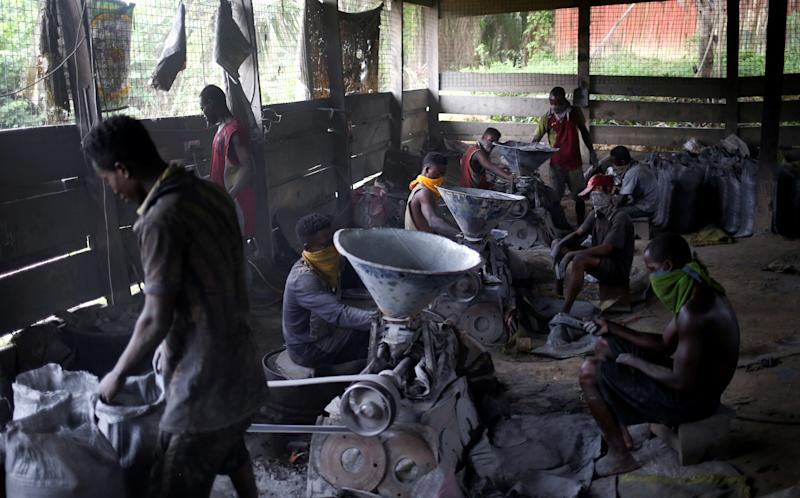 Artisanal miners take a break in Prestea, a mining town in southwest Ghana. People of Prestea are Wassa people; they have fought wars against the British, and some were captured and made slaves. (Photo: Siphiwe Sibeko/Reuters)