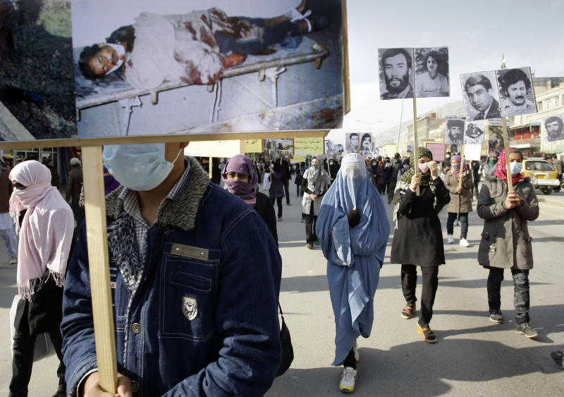 Afghan protesters carry portraits of Afghans who were killed in the past three decades of war and violence during a demonstration for human rights in Kabul, Afghanistan, Monday, Dec. 10, 2012. In a demonstration organized by the Social Association of Afghan Justice Seekers, dozens of Afghans who have lost their family members and relatives in the past three decades of war and violence in Afghanistan, marched in Kabul to mark International Human Rights Day asking for justice for the deaths of their loved ones. (AP Photo/Musadeq Sadeq)