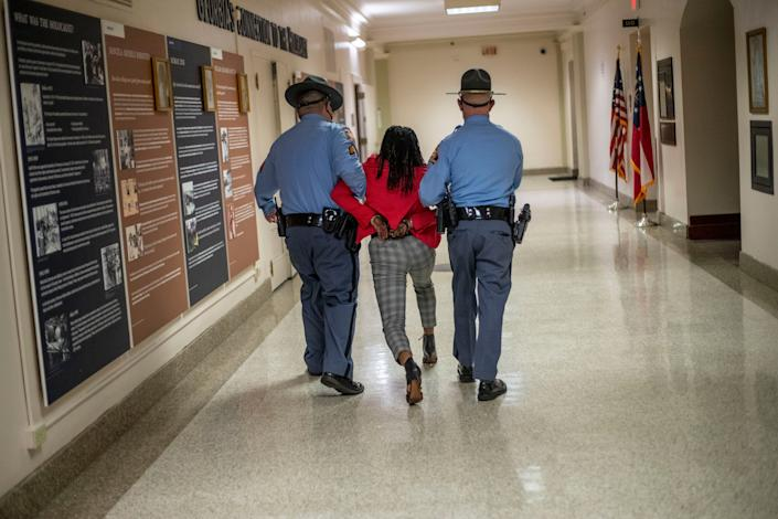 """""""She was advised that she was disturbing what was going on inside and if she did not stop, she would be placed under arrest,"""" the agency said in a statement. (Photo: Alyssa Pointer/Atlanta Journal-Constitution via Associated Press)"""