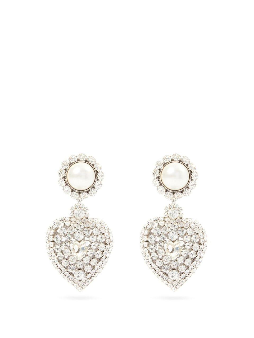 """<p>Alessandra Rich</p><p>Was £440.00</p><p>Now £264.00</p><p><a class=""""link rapid-noclick-resp"""" href=""""https://go.redirectingat.com?id=127X1599956&url=https%3A%2F%2Fwww.matchesfashion.com%2Fproducts%2FAlessandra-Rich-Faux-pearl-%2526-crystal-heart-clip-earrings-1409314&sref=https%3A%2F%2Fwww.elle.com%2Fuk%2Ffashion%2Fwhat-to-wear%2Fg36616066%2Fmatches-fashion-sale%2F"""" rel=""""nofollow noopener"""" target=""""_blank"""" data-ylk=""""slk:SHOP NOW"""">SHOP NOW</a></p><p>Clip-ons are great for those who don't want stretched earlobes. </p>"""
