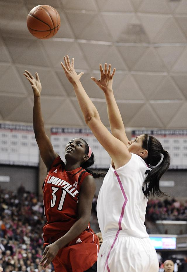 Louisville's Asia Taylor, left, shoots over Connecticut's Stefanie Dolson during the first half of an NCAA college basketball game on Sunday, Feb. 9, 2014, in Storrs, Conn. (AP Photo/Jessica Hill)