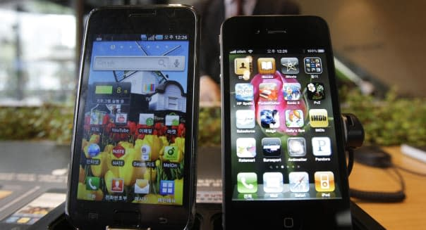 Samsung Electronics' Galaxy S, left, and Apple's iPhone 4 are displayed at the headquarters of South Korean mobile carrier KT in Seoul, South Korea, Friday, April 22, 2011. South Korea's Samsung Electronics Co. says it sued Apple Inc. for patent rights violations, only days after Apple sued Samsung for the same reason.(AP Photo/Ahn Young-joon)