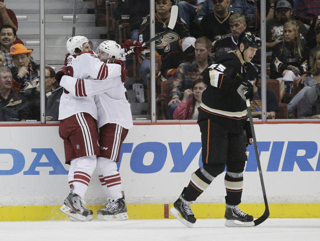 Phoenix Coyotes' Antoine Vermette, left, celebrates his goal with Keith Yandle as Anaheim Ducks' Bryan Allen, right, skates away during the second period of an NHL hockey game on Friday, Oct. 18, 2013, in Anaheim, Calif. (AP Photo/Jae C. Hong)