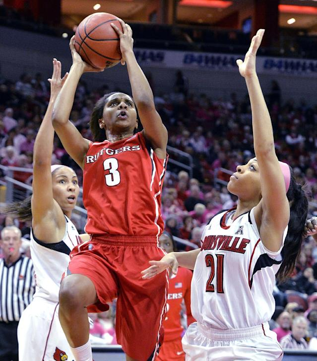 Rutgers' Tyler Scaife, center puts up a shot between the defense of Louisville's Tia Gibbs, left, and Bria Smith during the first half of an NCAA college basketball game, Sunday, Feb. 23, 2014, in Louisville, Ky. (AP Photo/Timothy D. Easley)