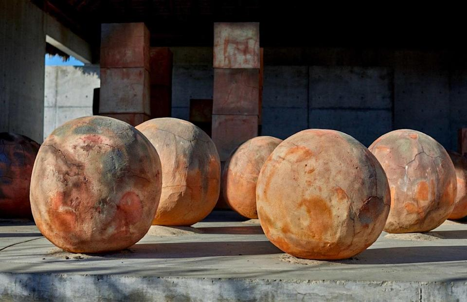 """Just as outdoor dining takes over sidewalks, art events are popping up in unclaimed corners. The Mexico-born artist <strong>Bosco Sodi</strong>'s latest installation—<em>Perfect Bodies,</em> presented by Pioneer Works and curated by the Noguchi Museum's <strong>Dakin Hart</strong>—comes to a vacant autobody lot in Brooklyn this weekend, for a three-month run. The show assembles more than twenty hulking forms, all made from the ruddy clay in Oaxaca, where Sodi's studio is located; by coincidence, the neighborhood where <em>Perfect Bodies</em> takes place—Red Hook—earned its name from a similarly colored ground. The artist describes the work touching on themes of """"silence, contemplation, and the passing of time—the small things in life and our relationship with the earth."""" Even on concrete, there's fertile potential."""